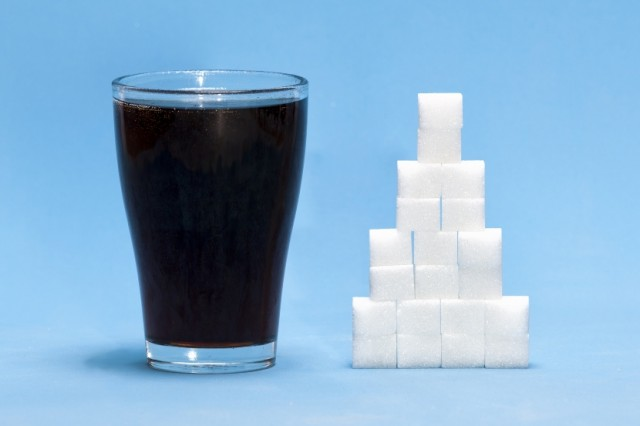 Sugary Beverage with Stack of Sugar Cubes