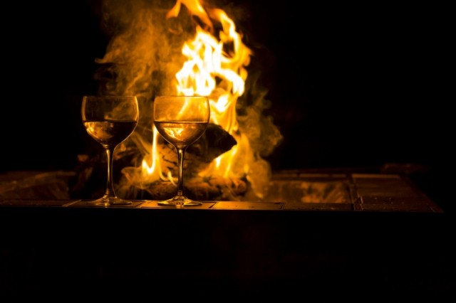 Wine Glass With Fire in Background