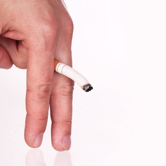 Limp Cigarette in Fingers